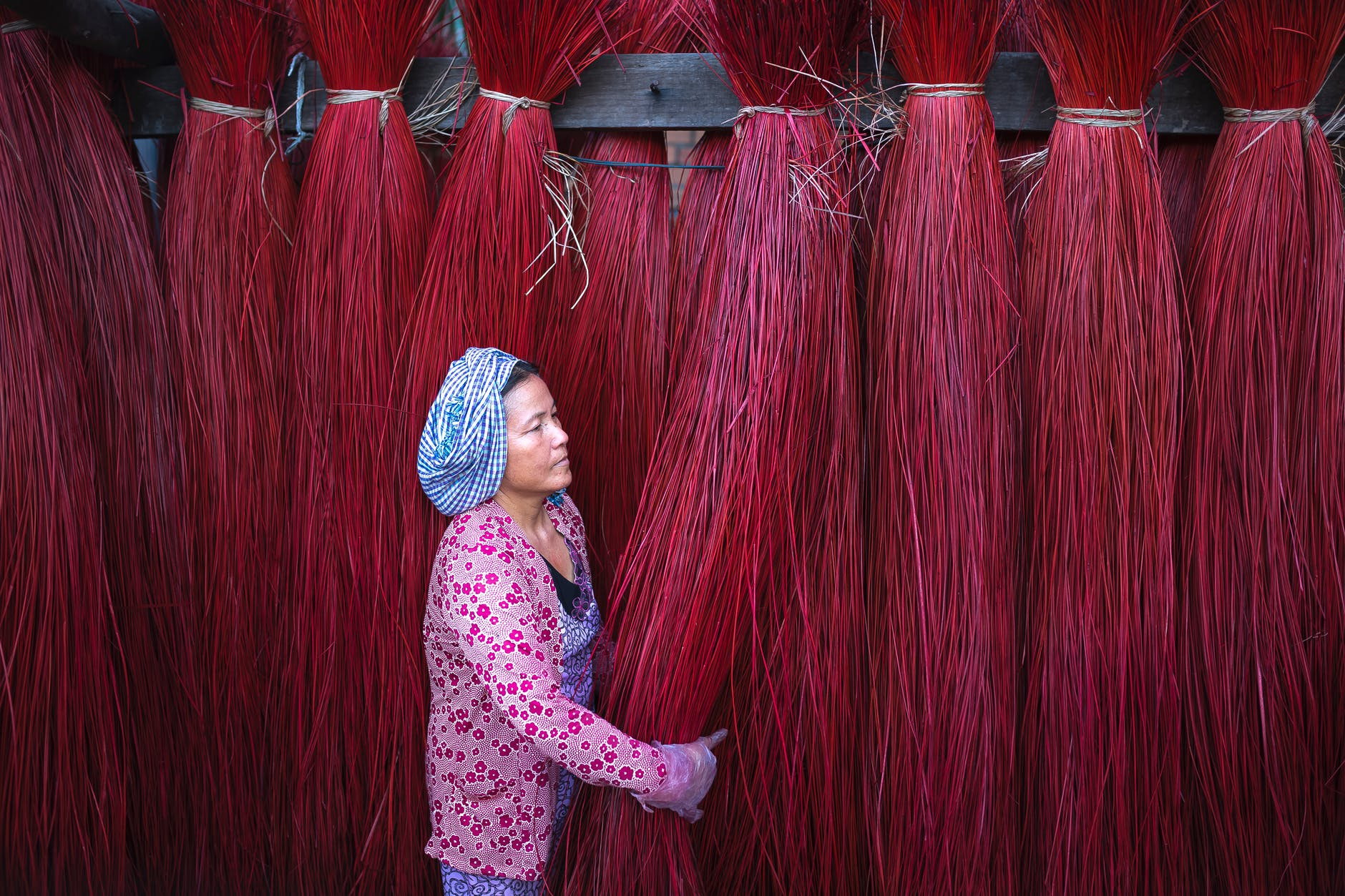woman holding red ropes